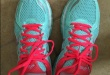 wearing ASICS Womens girl female Kayano 21 Running Shoe on feet test blue color