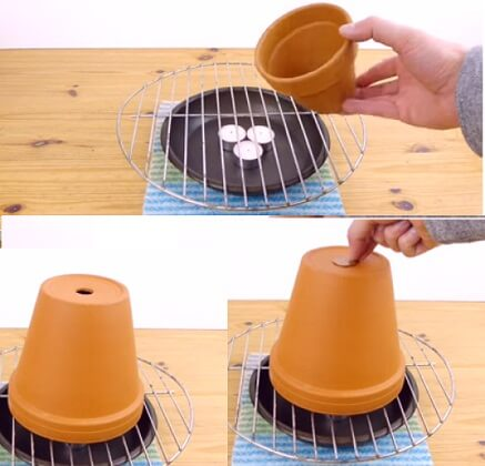 Make a room heater using candles terracotta plant pots